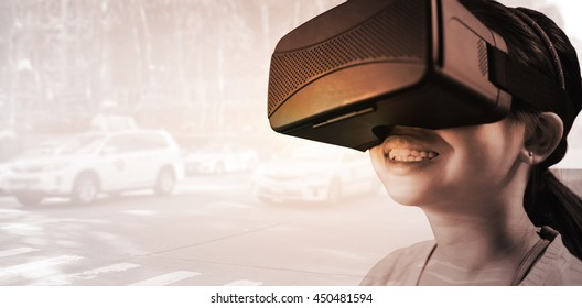 Close up of little girl holding virtual glasses against view of a city