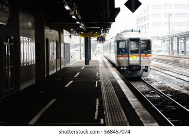 Close up of local train arrive to railway station in the winter Japan.