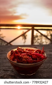 Close up of locally sourced crayfish from lake in the background for the annual swedish crayfish party