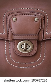 Close up Lock on Woman leather bag.