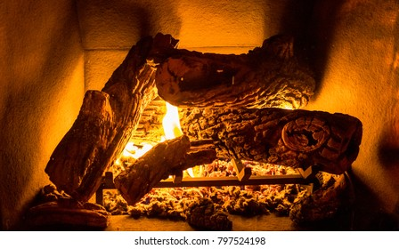 Close up of logs burning in a fireplace