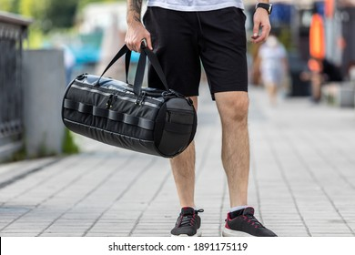 Close up look of the clothes and style of a man on the street