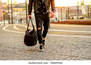 Close up look of the clothes and style of a man on the street in the sunset