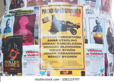 Close up look colorful advertising flier posters covering on street lamp post for public advertising about show, concert, motorbike and product on walking street Karlstad, Sweden. 13 April 2018