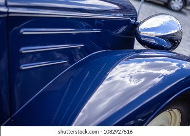 A close up look at an old classic blue car. Retro automobile exterior scene. Old vehicle.