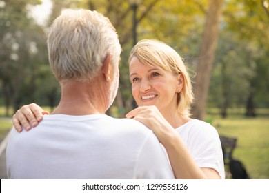 Close up of loving aged woman and man looking in eyes having romantic moment. Relationship goal concept