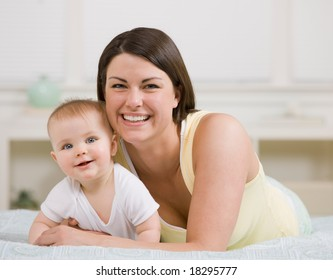 Close up of loving mother and baby posing at home