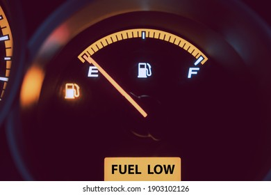 Close up low fuel guage shown in a car
