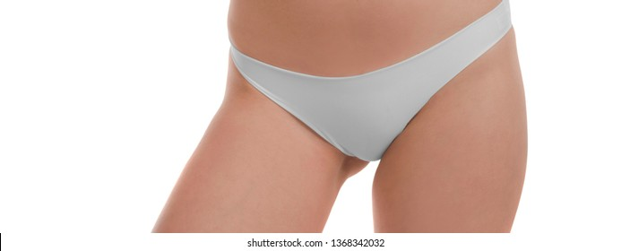 close up of lower body of a female model with perfect body isolated on white background