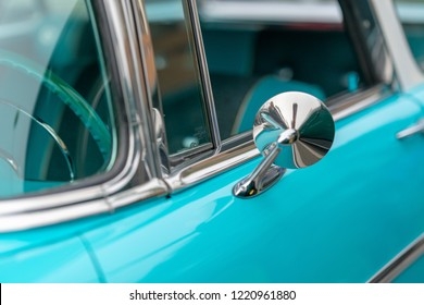 Close up of lue vintage car door and side mirror