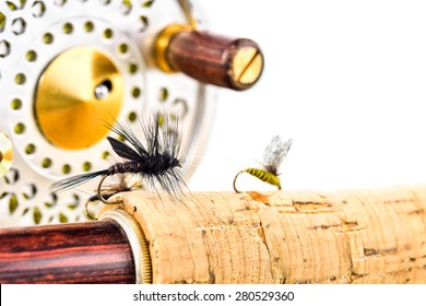 Close up of lure  fly fishing, rod and reel on white background