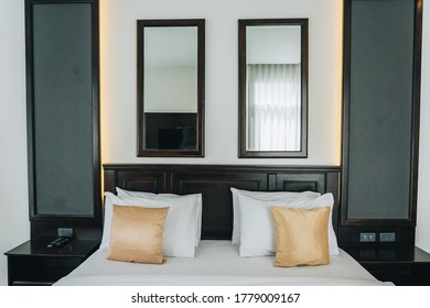 Close up luxury double bed in a hotel bedroom.