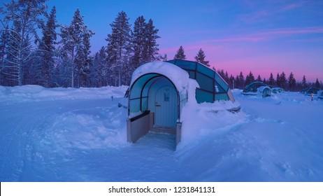 CLOSE UP Luxury glass igloo in Kakslauttanen Arctic Resort Finland at sunset