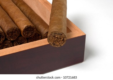 Close up of a luxury humidor with torpedo hand-rolled cigars in a maduro leaf wrapper.