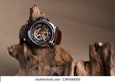 Close up of Luxury man wrist watches placed on timber in brown background or isolated