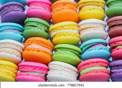 Close up  macaron dessert  pastel tones  isolated on white background , It is a dessert made from meringue with egg white, iced sugar, white sugar, almond powder  And food  shape like a sandwich.