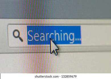 Close up macro of internet browser address bar with searching text selected with mouse arrow pointer.