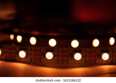 Close up macro of orange LED strip in coil