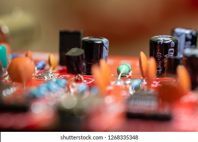 Close up (Macro) of Printed Circuit Board PCB embedded components (inductors, resistors, capacitors, diodes, microchips, transistor) with short depth of view.