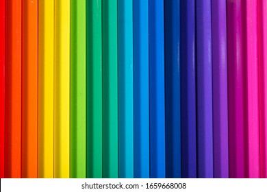close up macro shot of colorful pencils on  black background