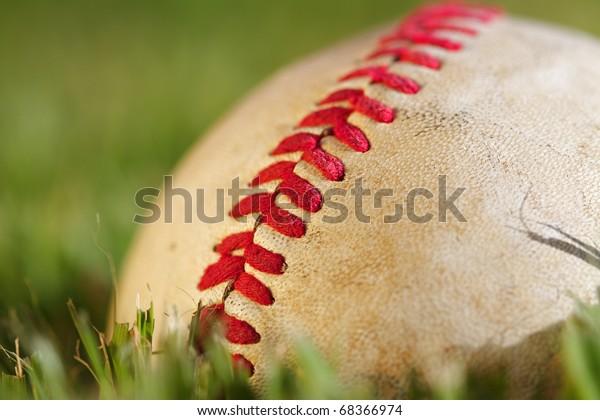 Close up macro view of the seams on a used baseball