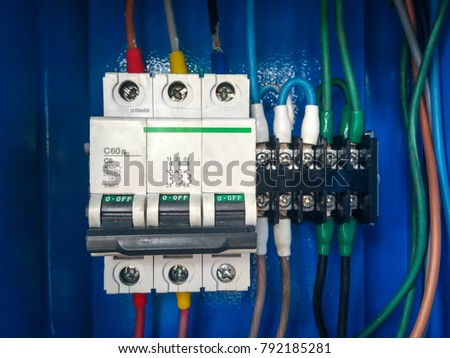 Close Up Magnetic Contactor In Blue Electrical Closet.