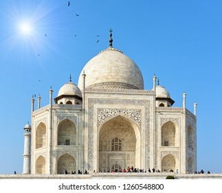 Close up of the majestic Taj Mahal in India with sunburst in the left upper corner