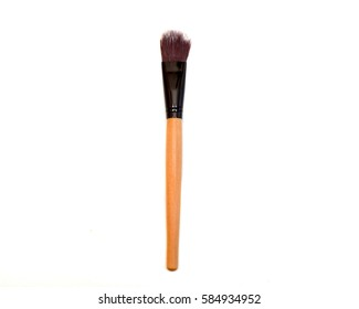 close up of a make up brush on white background