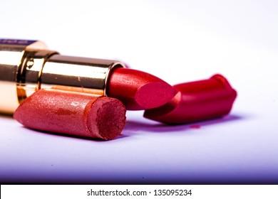 close up of a  make-up accessories -powder, eyeshadow,lipstick