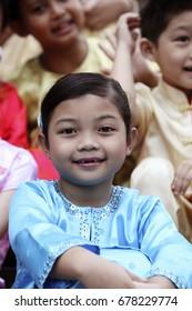 Close up of Malay girl wearing baju kurung