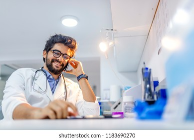 Close up male doctor or medical student using mobile smart phone working  in hospital with copy space, electronic health records system EHRs, teleconference or telemedicine concept.