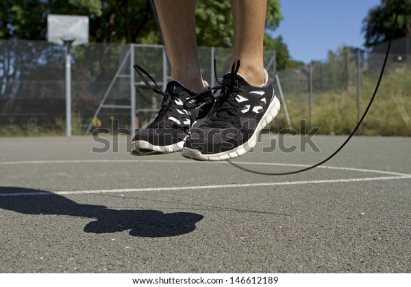 Close up of male feet jumping in mid air whilst using a Skipping Rope