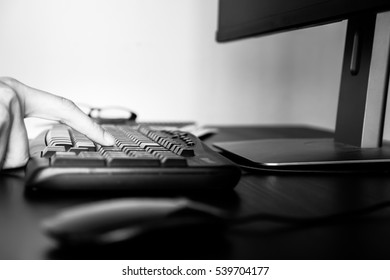 Close up of Male finger pushing the button of keyboard, black and white tone
