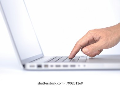 Close up Male forefinger pressing keyboard button of laptop, Aluminum body, isolated on white background