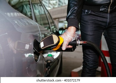 Close Up Of Male At Gas Station Filling Up His Car With Petrol