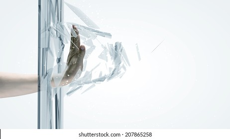 Close up of male hand breaking glass with palm
