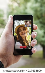 Close Up Of A Male Hand Holding A Smart Phone During A Video Call With His Girlfriend