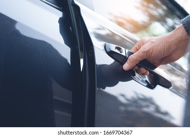 Close up of a male hand opening a car door