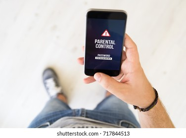 close up of male hand with parental control smart phone