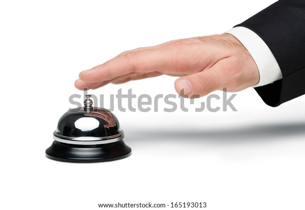 Close up of male hand pressing a service bell isolated on white  background