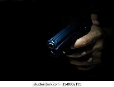 Close up male hand showing gesture try to kill someone with gun, Gunman with dark background