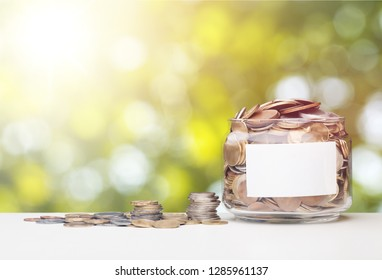 Close up of male hand stacking gold coins with green bokeh background ,Business Finance and Money concept,Save money for prepare in the future.
