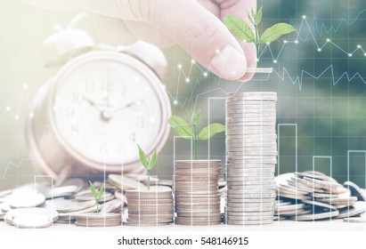 Close up of male hand stacking gold coins with green bokeh background and business graph ,Business Finance and Money concept,Save money for prepare in the future.Trees growing on coin