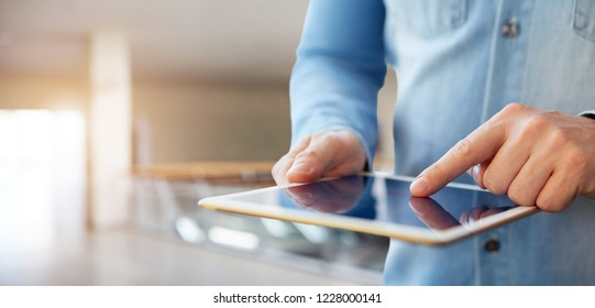 Close up of a male hand touching a digital tablet