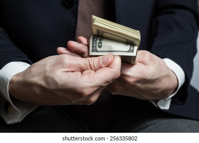 Close up of male hands with money.