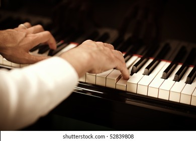 close up of male hands playing piano. Horizontal shape, copy space