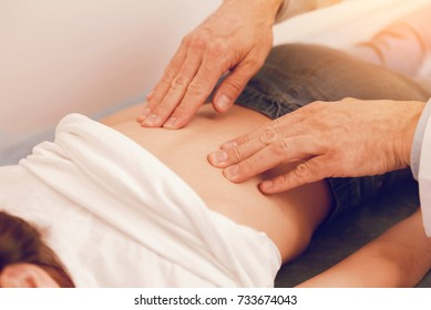 Close up of male hands that massaging girl
