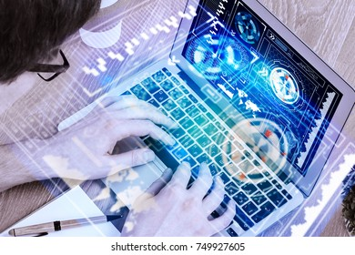 Close up of male hands using laptop with abstract digital interface at office desk. Innovation and future concept. Double exposure