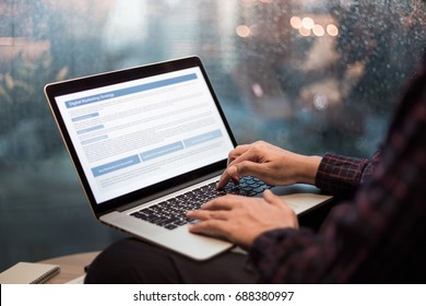 Close up male hands using or typing computer laptop in night city view.business activity,connectivity,freelance concepts