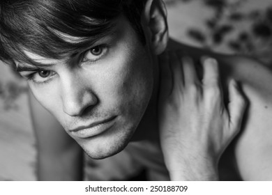 Close up of male head shot. Holding on the shoulder. Black and white portrait.